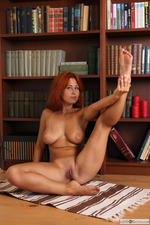 Busty Redhead April Is Nude In The Library-08