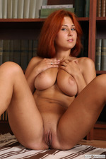 Busty Redhead April Is Nude In The Library-10