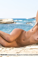 Beautiful Brunette Posing Naked By The Sea-05