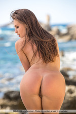 Beautiful Brunette Posing Naked By The Sea-09