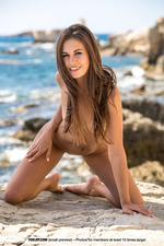 Beautiful Brunette Posing Naked By The Sea-10