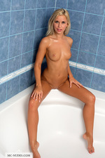 Naked Lola takes a hot shower-10