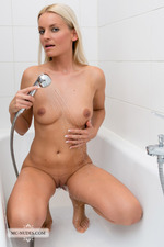 Busty April Takes A Shower-04