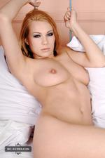 Busty Zenia Posing Among Pillows-07