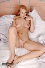 Busty Zenia Posing Among Pillows-09