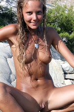 Naked girl posing by the lake-14
