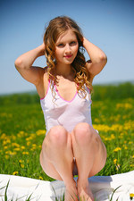 Naked girl posing for us at the field-05