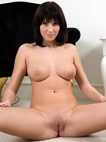 Naked busty babe opens her pussy