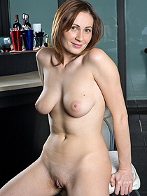 Naked girl in the kitchen