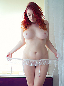 Busty redhead girl has really sexy body