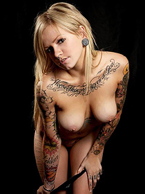 Busty tattooed girl