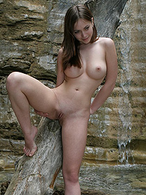 Busty Teen Brunette Is Nude By The Rocks