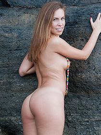 Naked Brunette Teen Posing On The Rocks