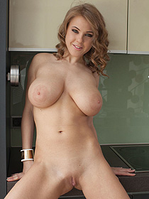 Busty Vanea Strips In The Kitchen