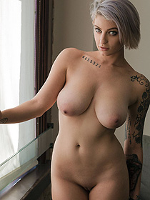 Busty Tattooed Hottie