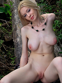 Busty Blondie Is Nude In The Forest