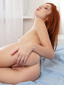 Lovely Redhead Teasing In Her Bed