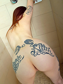 Tattooed Redhead Chick Takes A Hot Shower