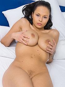 Busty Domino Looks Damn Sexy