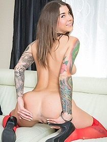 Tattooed Felicity In Sexy Red