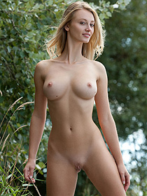 Busty Carisha Is Nude In The Forest