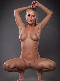 Busty Blonde Sarika Posing In The Studio