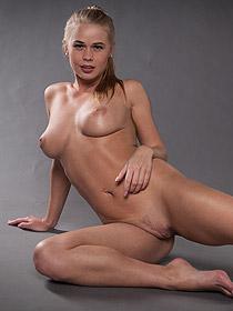 Busty Sarika Posing In The Studio