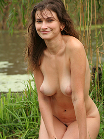 Busty Brunette Teen Posing At The Lake