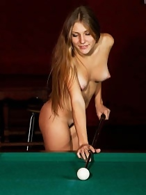 Naked pool player presenting her hairy pussy