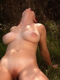 Naked busty redhead amateur posing outdoor