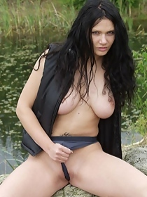 Naked natural busty chick by the lake