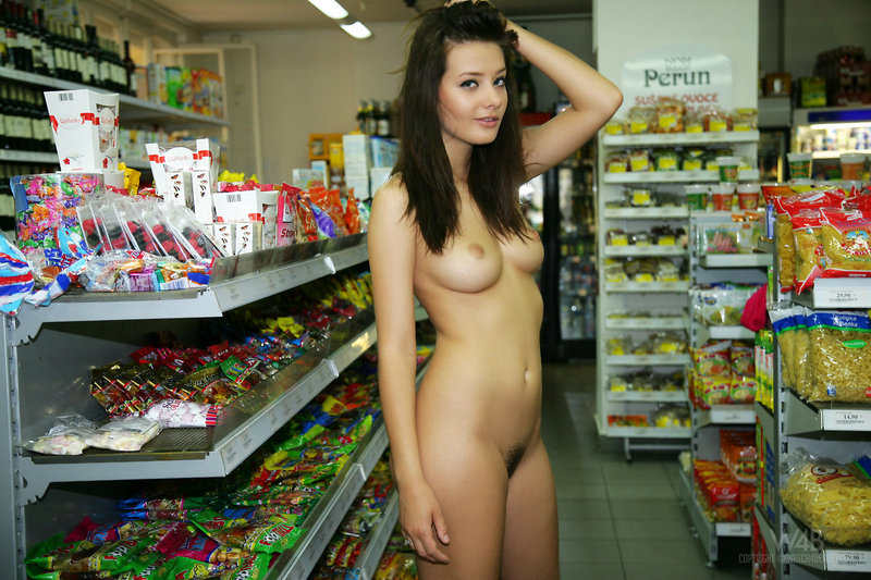 Naked girl presenting her body in public-01